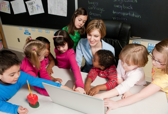 First, second, and third graders in a classroom